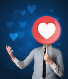 Businessman holding heart sign Royalty Free Stock Image