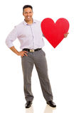 Businessman holding heart symbol Stock Images