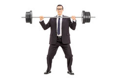 Businessman holding a heavy weight Stock Image