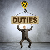 Businessman holding heavy word duties Royalty Free Stock Photo