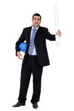 Businessman holding a helmet. And a blueprint Stock Images