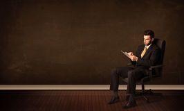 Businessman holding high tech tablet on background with copyspac Royalty Free Stock Photos