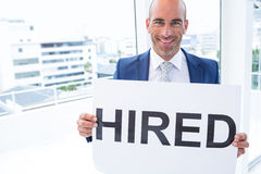 Businessman holding a hired sign Stock Image
