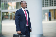 Businessman holding his briefcase Royalty Free Stock Photography