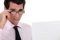 Businessman holding his glasses Stock Photo