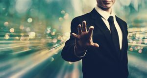 Businessman holding his hand. On blue tech background royalty free stock photography