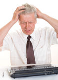 Businessman holding his head Royalty Free Stock Photography