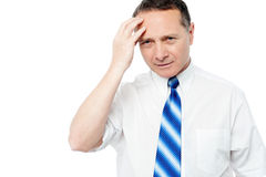 Businessman holding his head Stock Photography
