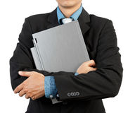 Businessman holding his laptop Royalty Free Stock Images