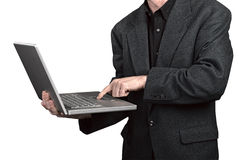 Businessman holding his laptop Royalty Free Stock Photos