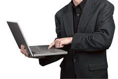 Businessman holding his laptop Royalty Free Stock Photos