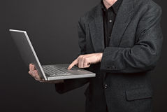 Businessman holding his laptop Royalty Free Stock Photography
