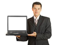 Businessman holding his laptop with white screeen Stock Images