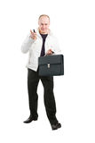 Businessman holding his mobile and case in hands Royalty Free Stock Image