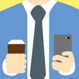 Businessman holding his mobile and coffee in another hand. Royalty Free Stock Image