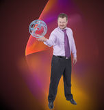 Businessman holding his right hand out, palm up with sphere Stock Photos