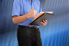Businessman is holding his  thumb up Royalty Free Stock Photo