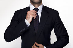 Businessman. Holding his tie in a suit Stock Image