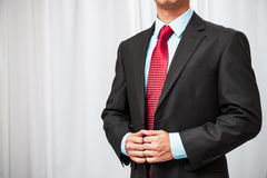 Businessman holding his tuxedo Royalty Free Stock Photo