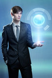 Businessman holding hologram of the earth Royalty Free Stock Photo
