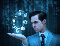 Businessman holding a hologram with smartphone applications Stock Photo