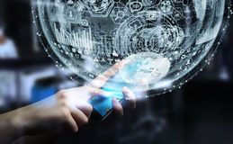 Businessman holding hologram sphere 3D rendering. Businessman holding white and blue hologram sphere over mobile phone 3D rendering Stock Image