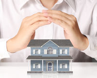 Businessman holding home model Stock Images