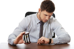 Businessman holding hourglass. Royalty Free Stock Photography