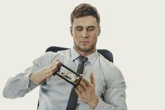 Businessman holding hourglass. Stock Photos