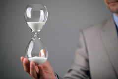 Businessman holding hourglass. Hourglass timer concept for business deadline and leadership Royalty Free Stock Photo