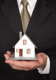 Businessman Holding House Stock Image