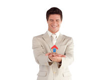 Businessman holding a house Royalty Free Stock Photos