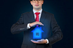 Businessman holding house Royalty Free Stock Photography