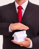 Businessman holding house in the hands. Royalty Free Stock Photography