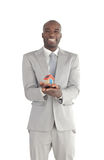 Businessman holding a house in his hands Stock Photography