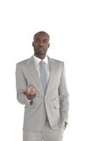 Businessman holding a house in his hands Royalty Free Stock Photo
