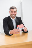 Businessman holding a house model Stock Photo