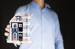 Businessman holding house .real estate investment concept Stock Photo