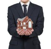 Businessman holding house Stock Photography