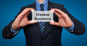 Businessman holding Human Resource sign Stock Photo