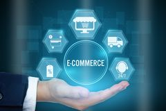 Businessman holding icon of E-commerce concept ,Creative design. For banner royalty free stock photo