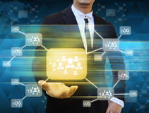 Businessman holding icon of social network Stock Photo