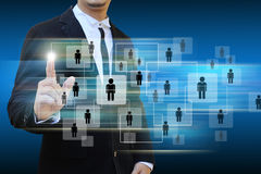 Businessman holding icon of social network Royalty Free Stock Images