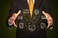 Businessman holding networking icons. Businessman holding icons related to devices and communication Stock Photo