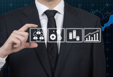 Businessman holding icons Stock Photo