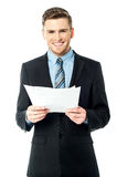 Businessman holding important deal documents Stock Photography