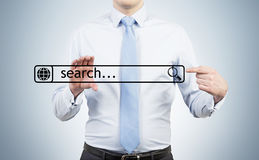 Businessman is holding the internet search bar in their hands. Royalty Free Stock Images
