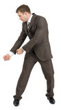 Businessman holding invisible axe Royalty Free Stock Photos