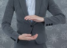 Businessman holding invisible object with pattern background Stock Image