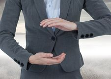 Businessman holding invisible object with sea background Royalty Free Stock Image